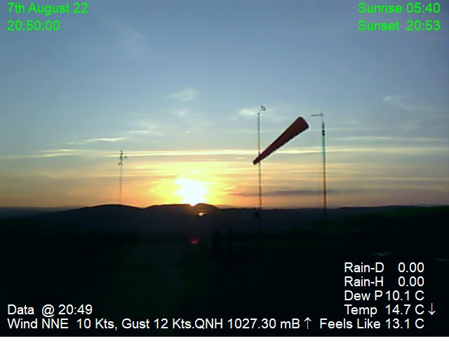 Pointing west to windsock